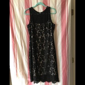 Black lace overlay. NWT.
